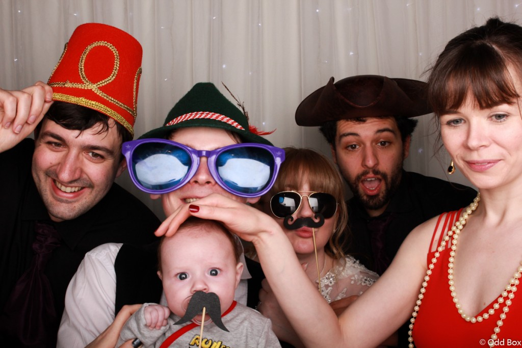 Cute baby with mustache in photo booth