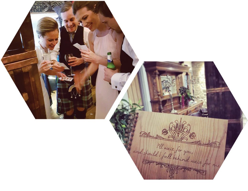 wedding guests enjoying a photo booth hire with whisky barrel booth and bespoke wooden guest book