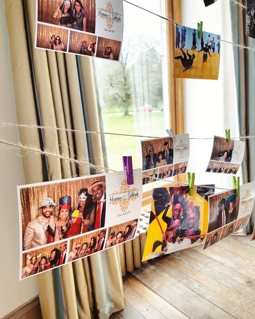 wedding photo booth prints pegged on washing line wedding guest book alternative idea