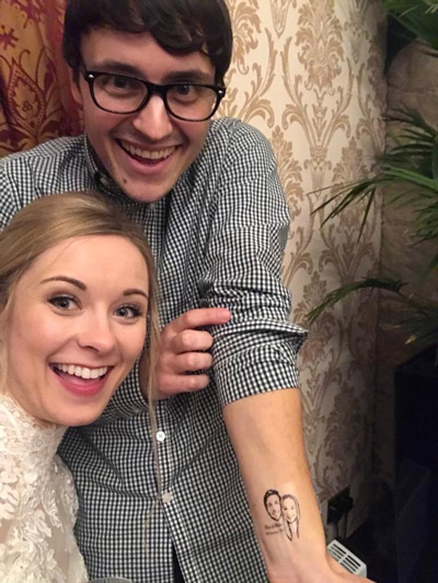 Shona and Ryan showing wedding tattoo at Glenbervie House Hotel