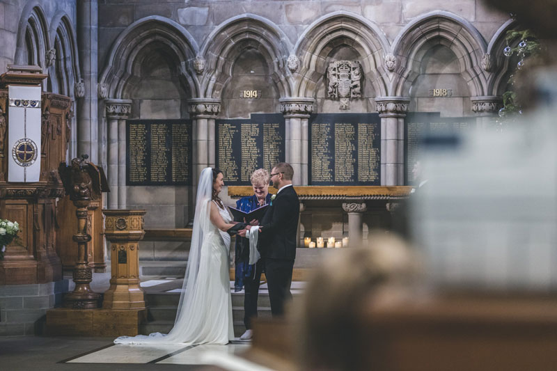 Philippa & Kristian hand in hand Maggie Kinloch wedding ceremony Glasgow University Memorial Chapel