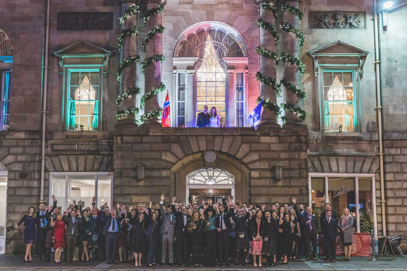 Philippa & Kristian outside The Trades Hall of Glasgow with their wedding guests