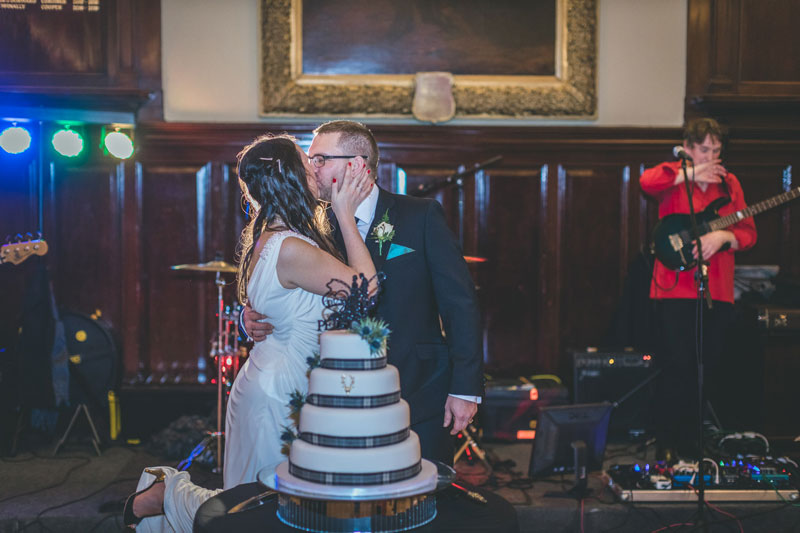 Bride & Groom cut the cake at Trades Hall of Glasgow Wedding