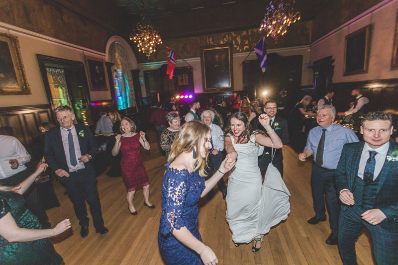 Guests dance with bride at Trades Hall of Glasgow Wedding