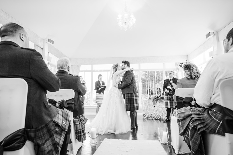 Bride and Groom first kiss after wedding ceremony Carlowrie Castle Edinburgh