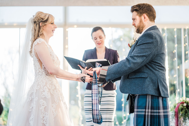 Bride and Groom perform Hand Fastening Humanist Ceremony at Carlowrie Castle Edinburgh