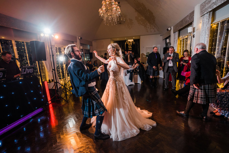 Bride and Groomsmen dance Carlowrie Castle wedding
