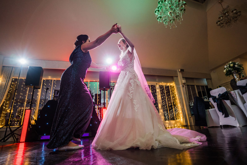Bride and bridesmaid dance Carlowrie Castle