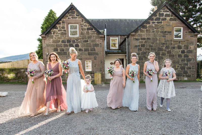 Bridesmaids dresses walk in courtyard Comrie Croft