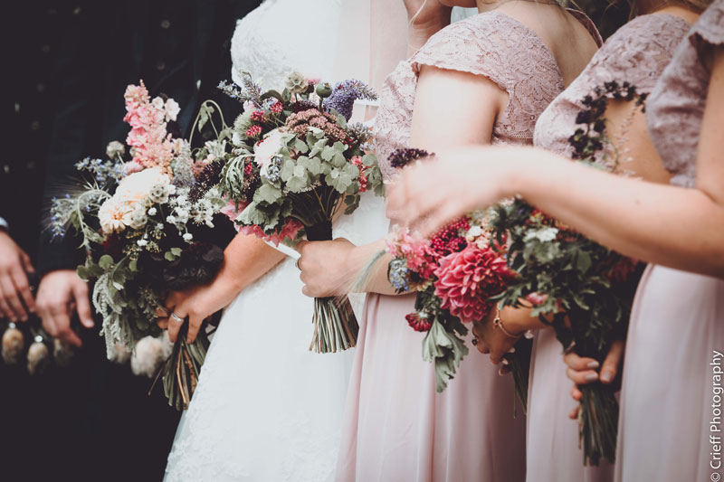 bride with bridesmaids and wedding flowers bouquets Comrie Croft