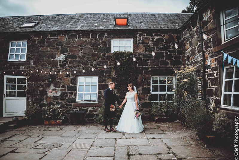 Nordic Courtyard Bride and Groom Outside Comrie Croft