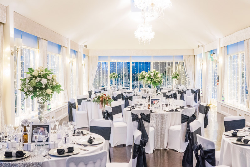 White and Silver wedding decor tables Carlowrie Castle