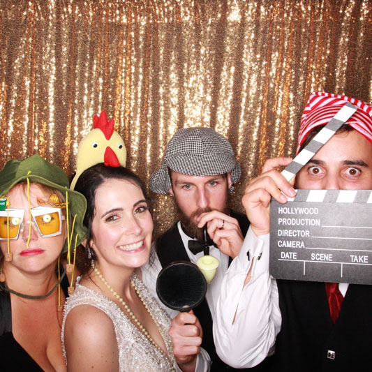 Guests using photo booth at Auchen Castle Wedding Beattock