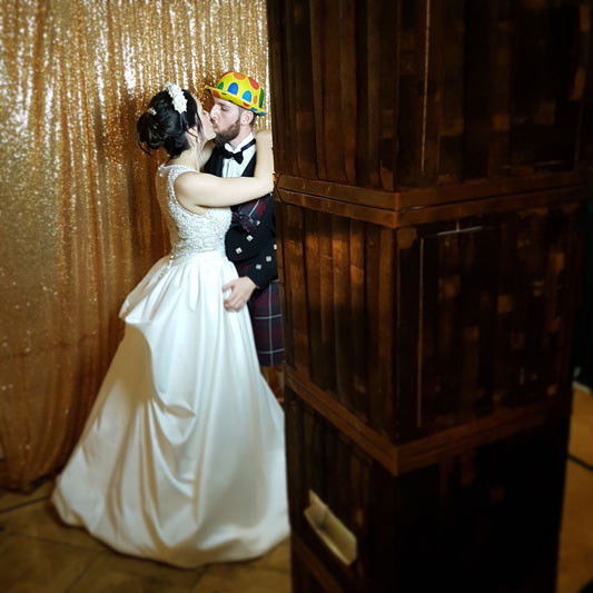 Bride and Groom first kiss in Auchen Castle Wedding Photo Booth